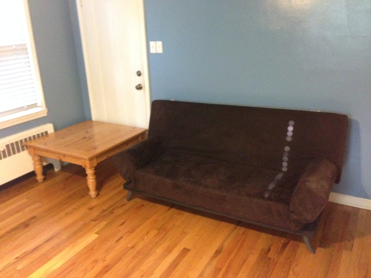 Couch in master bedroom