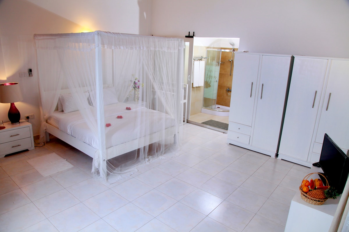 Special suite in white decor above the pool upper level