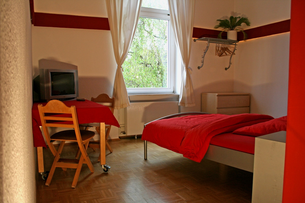 Red Room with table, TV and wardrobe