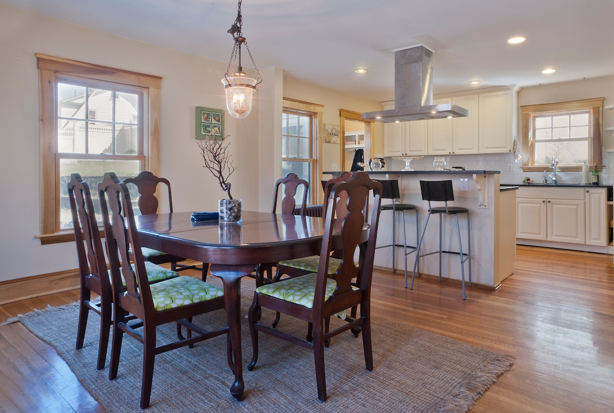 Formal dining table with open layout kitchen