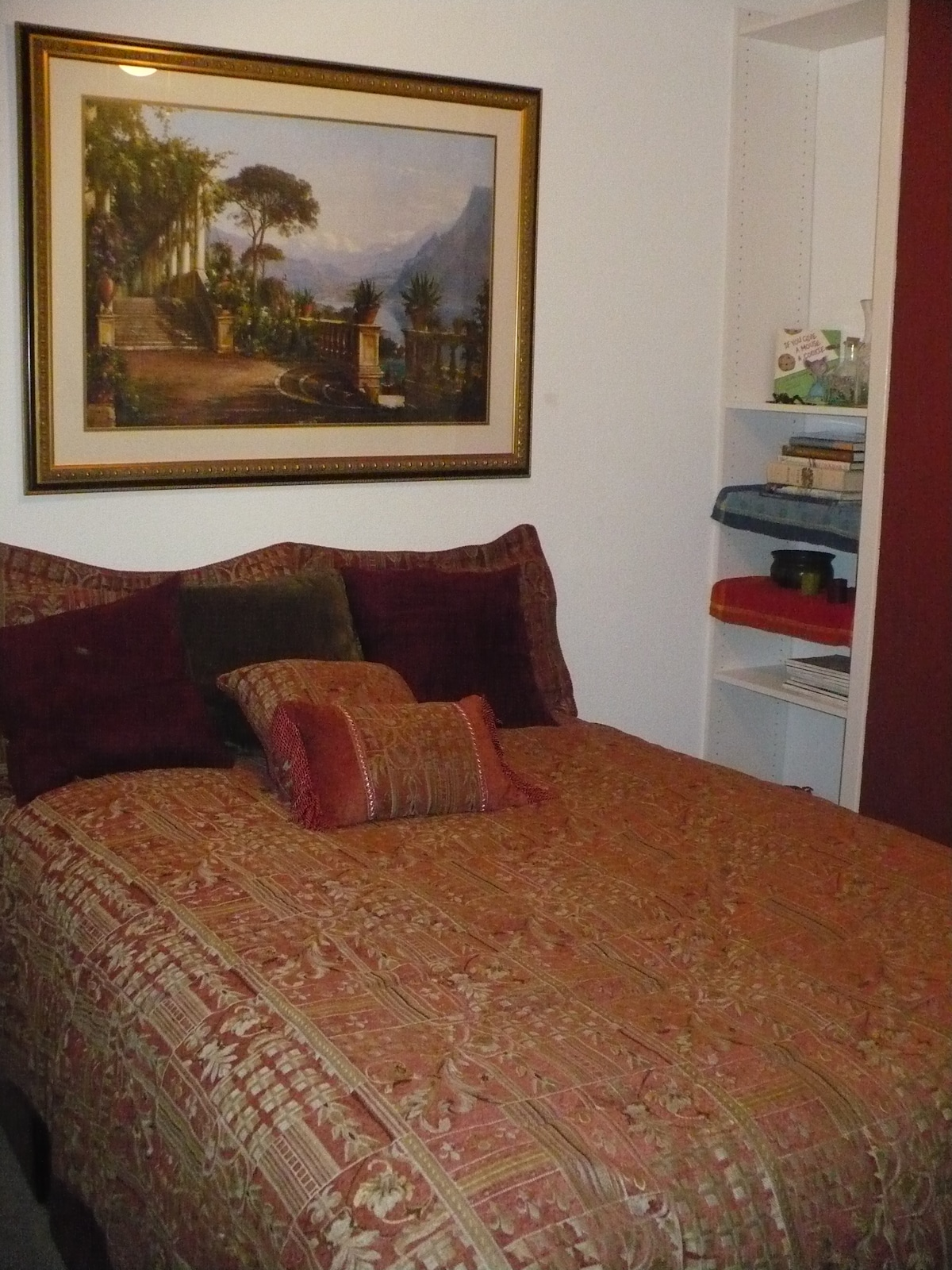 Comfortable queen bed with luxurious linens for guests.
