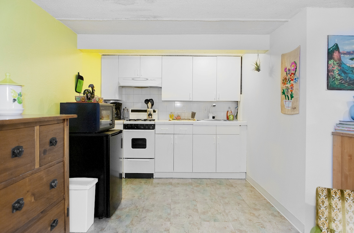 Charming kitchen with vintage charm and all the amenities you will need (pots, pans, dish ware, silverware, cups, glasses, cooking utensils, coffee pot, toaster)