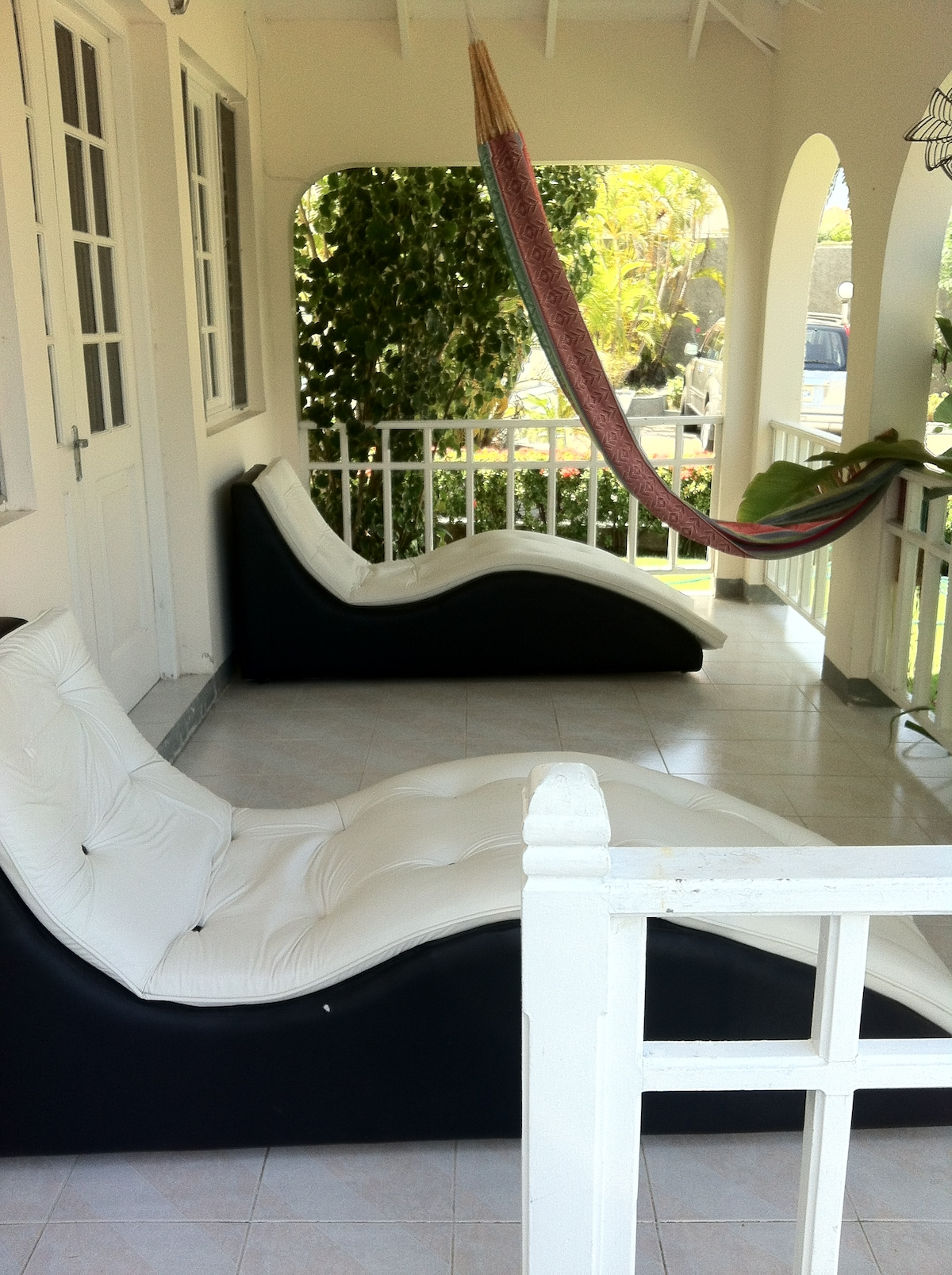 Loungers and hammock on the front patio