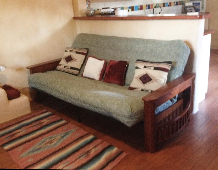 Queen-sized futon with super-thick deluxe mattress in living room
