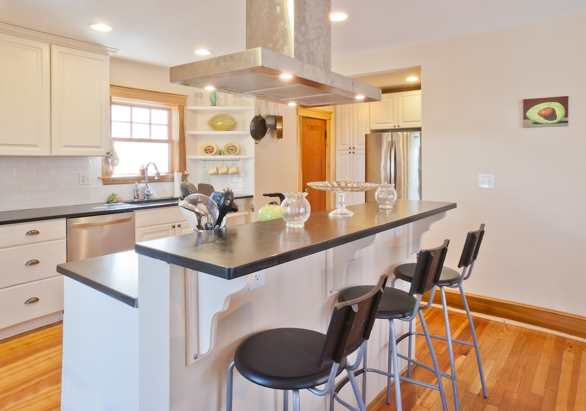 Bar seating countertop, with stainless steel kitchen for cooking every meal perfectly.