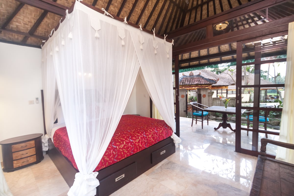 Large, spacious air-conditioned interior - private entrance surrounded large wrap around balcony with tropical gardens and fish ponds.