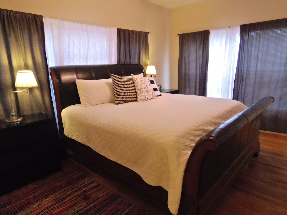 Master bedroom has hardwood floors and king bed with 1200 thread count sheets
