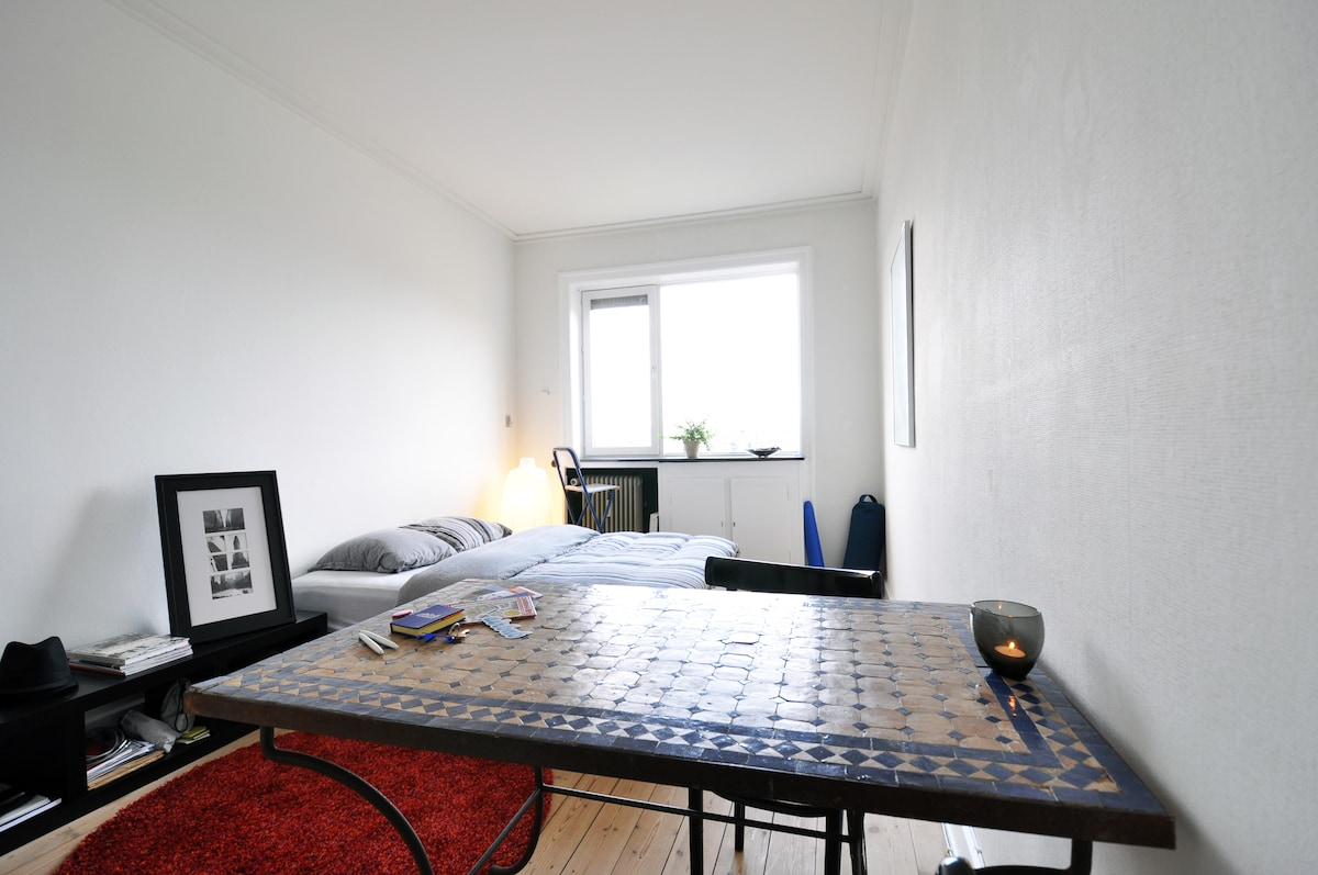 Your own bright and cozy private room with double bed, from the table!