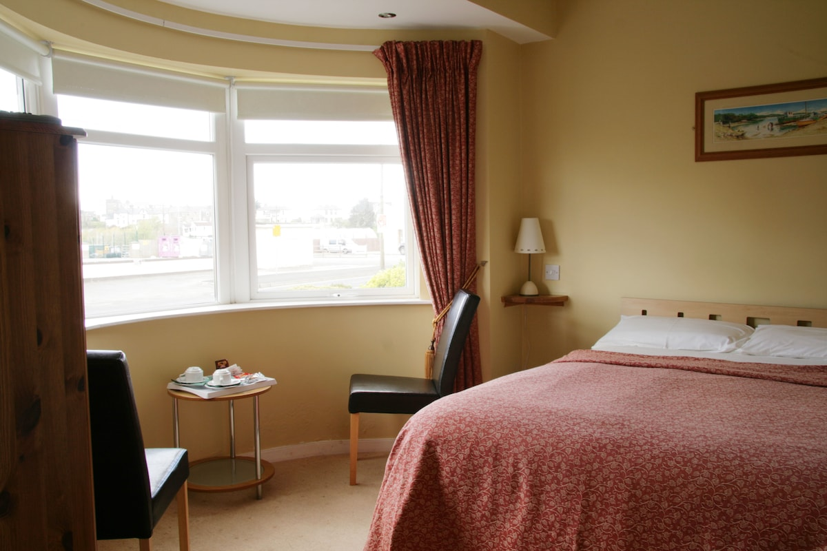 This is bedroom no 2 which is front facing - a lovely bright room .