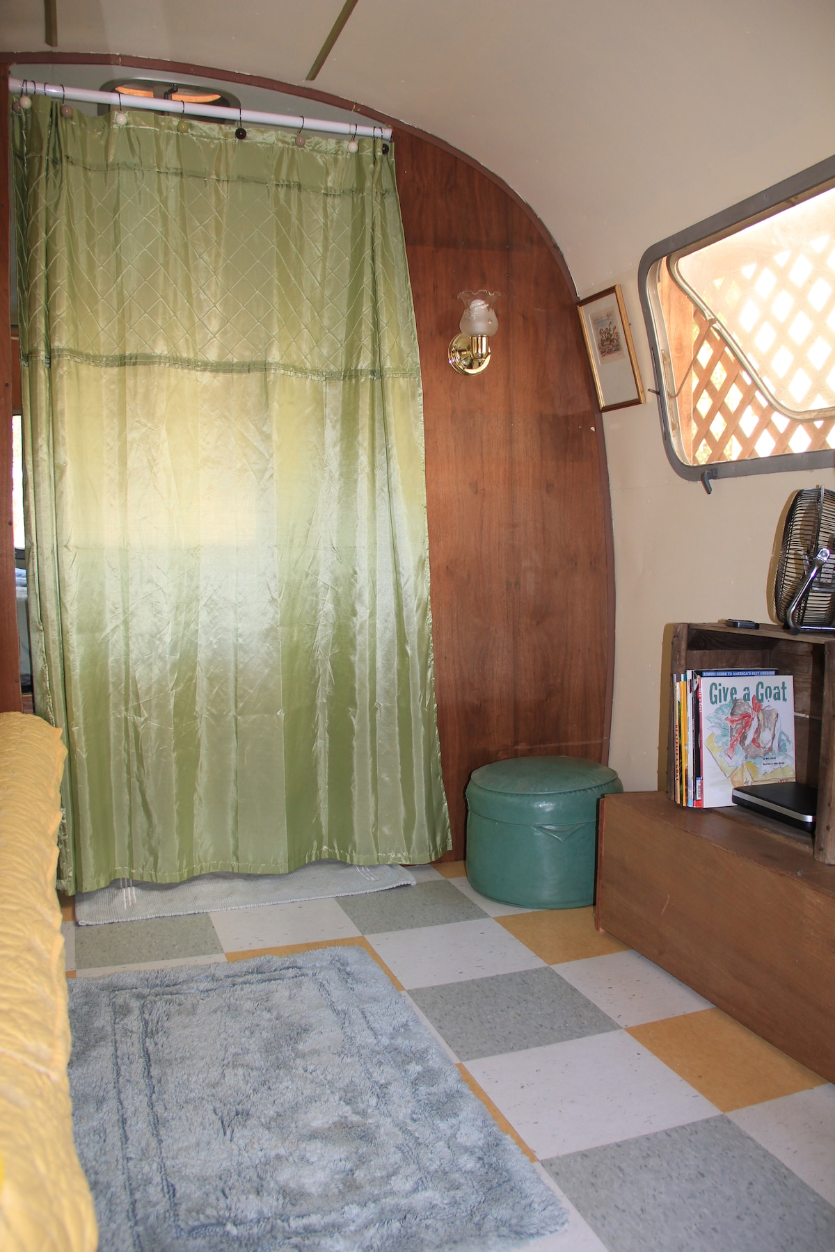 Sofa/twin bed sitting area with movies and small DVD player