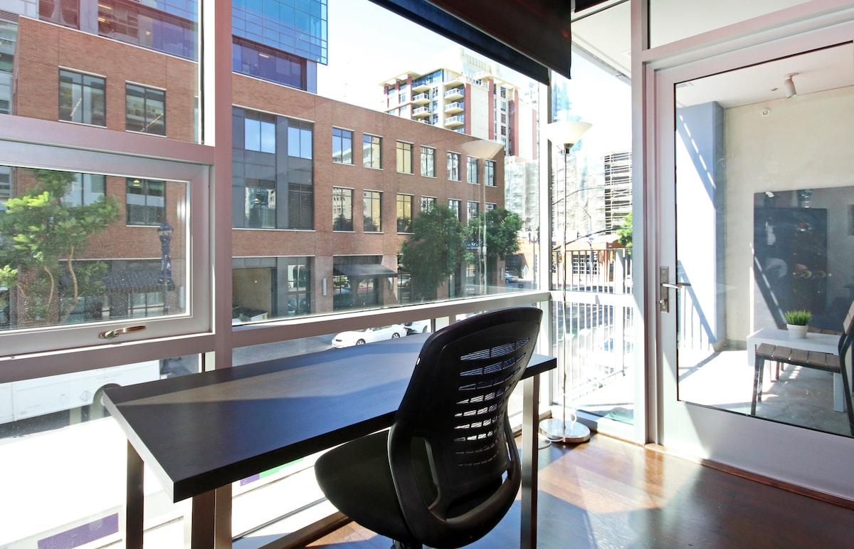 Work desk that overlooks an energetic bustling street