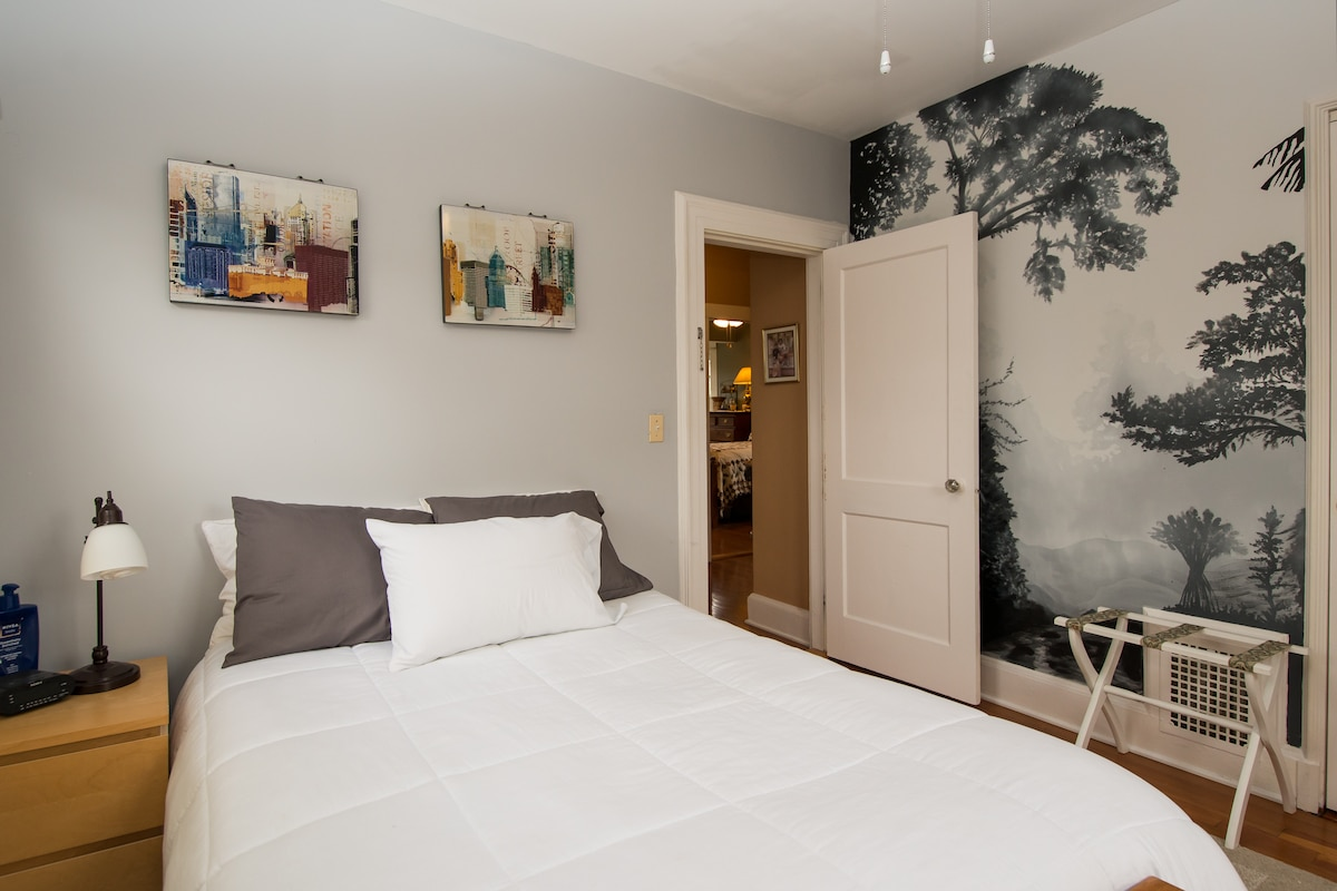 Guest room with futon bed and another wall mural painted by Jared.