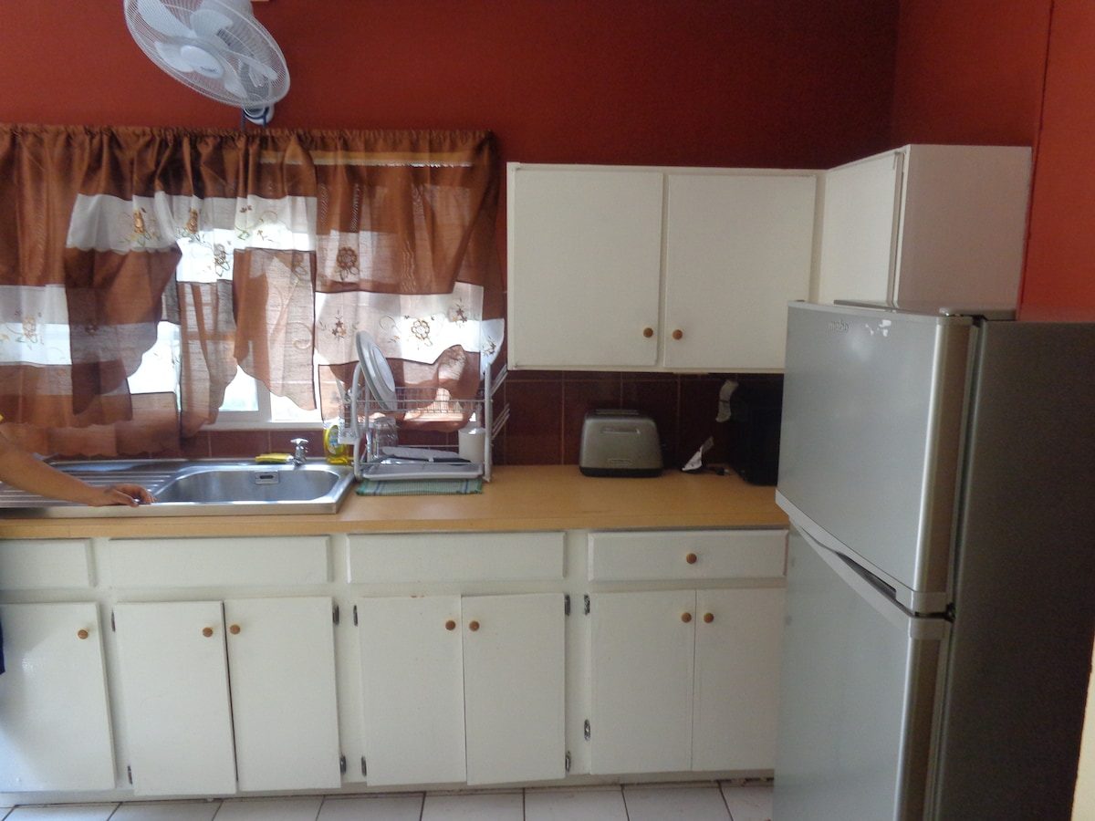 Full Kitchen.  Include: Fridge, Stove, Microwave, Toaster, Pots,  Kettles, Dishes, Drinking Glasses and other utensils