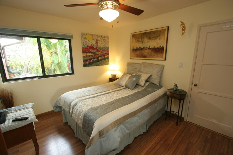 Bedroom with queen size pillow top bed and garden view