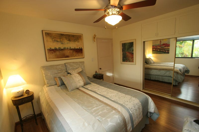 Bedroom with ceiling fan and central air