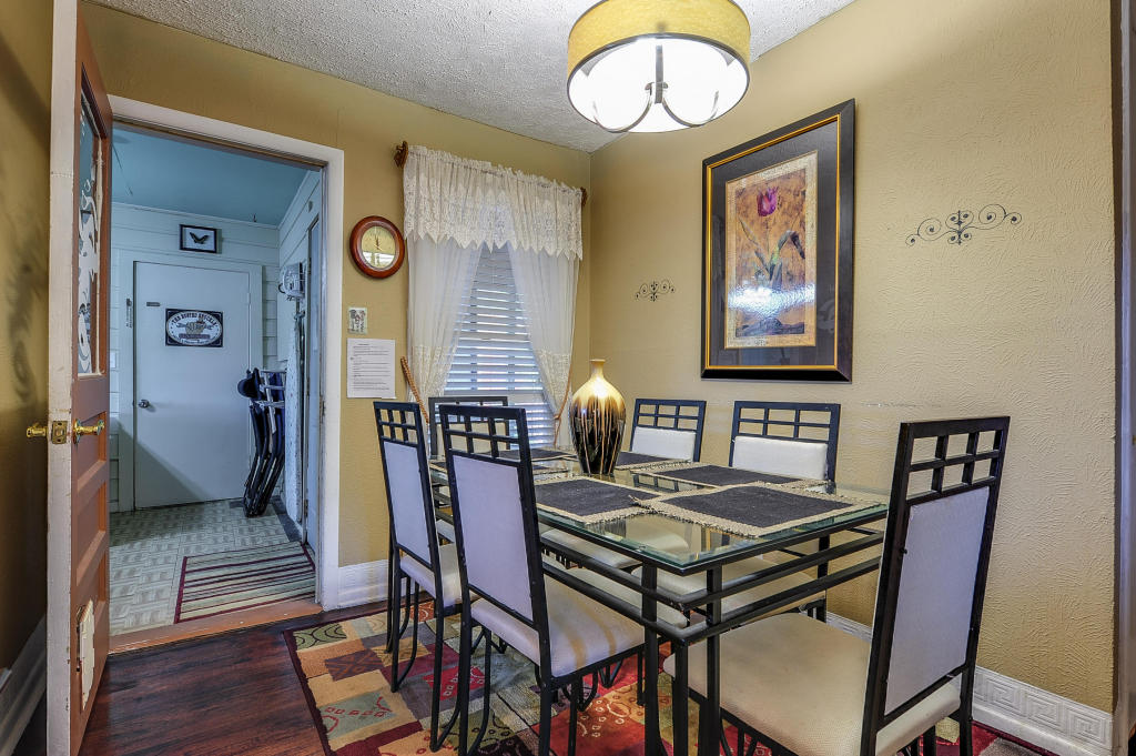 Dining area has room to seat 6 at the table together.  Just inside the open door to the left is an additional table that seats 5 more.  There are also 4 TV trays to be used if wanting to eat in other areas of the house, as well as extra comfortable patio