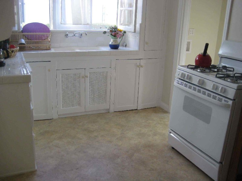 Redone, sunny eat-in kitchen has new ceramic tile, new floor tile, new plumbing and all-new appliances,