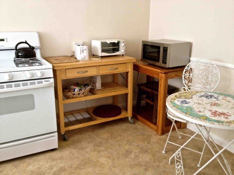 Kitchen includes long list of amenities and applicances, plus complimentary coffee, tea, spring water.