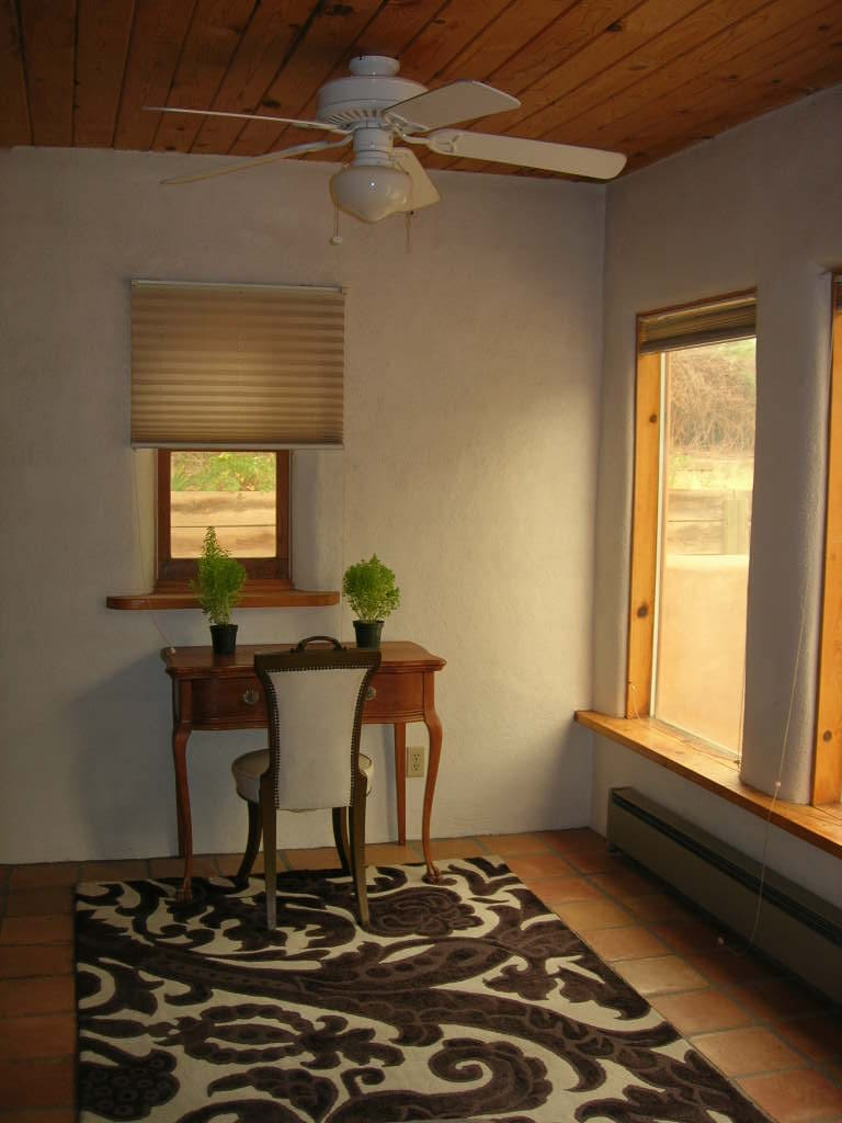 Writing desk with view of field and patio