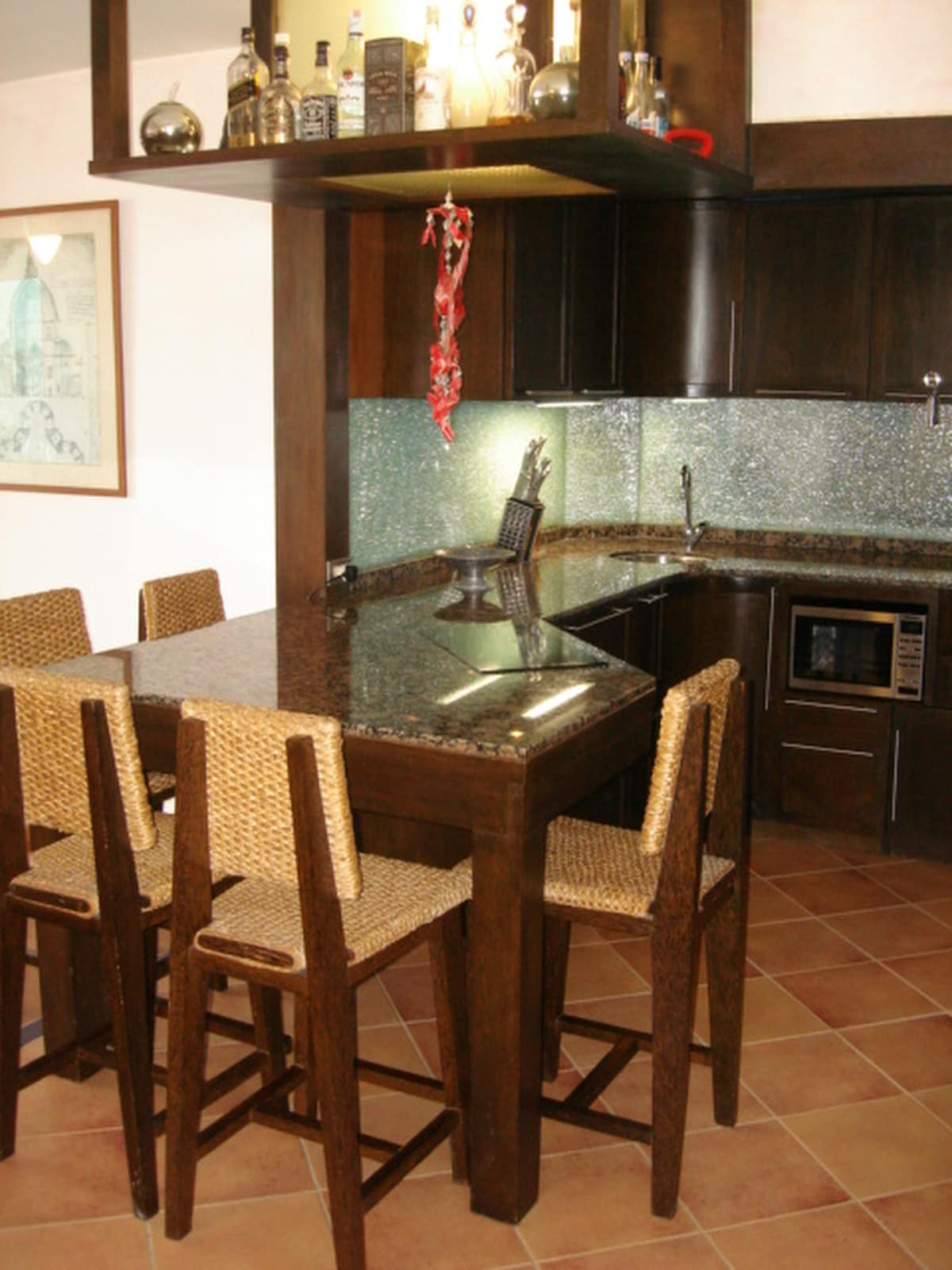 Kitchen with dining-table and bar