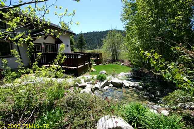 Great yard with a Koi Pond, hammock and grass for the kids to romp on!