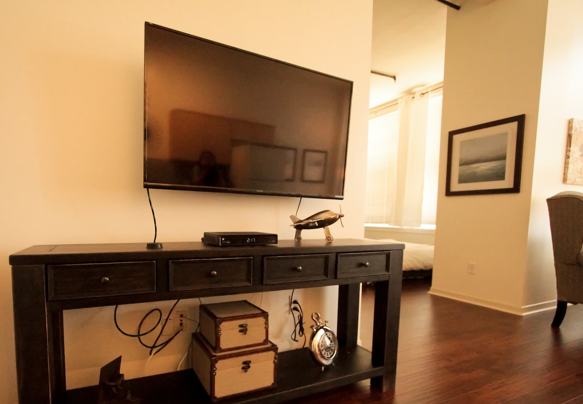 """48"""" flat screen TV with (website hidden) is motion mount and can be positioned for better viewing"""