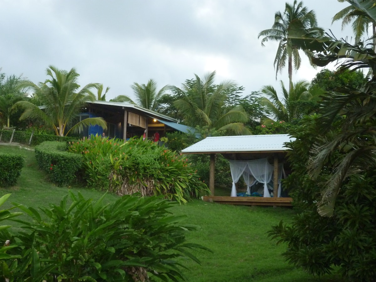 Main bure in the upper left with the previous yoga pavillion - before it housed the new room!
