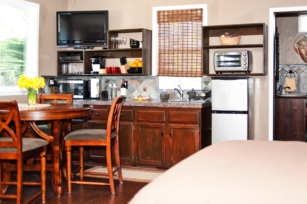 Fully Stocked Kitchenette w/ Flat Panel TV (Free Movies/premium channels), Microwave, Convection Over, Induction Cooktop and Refrigerator.