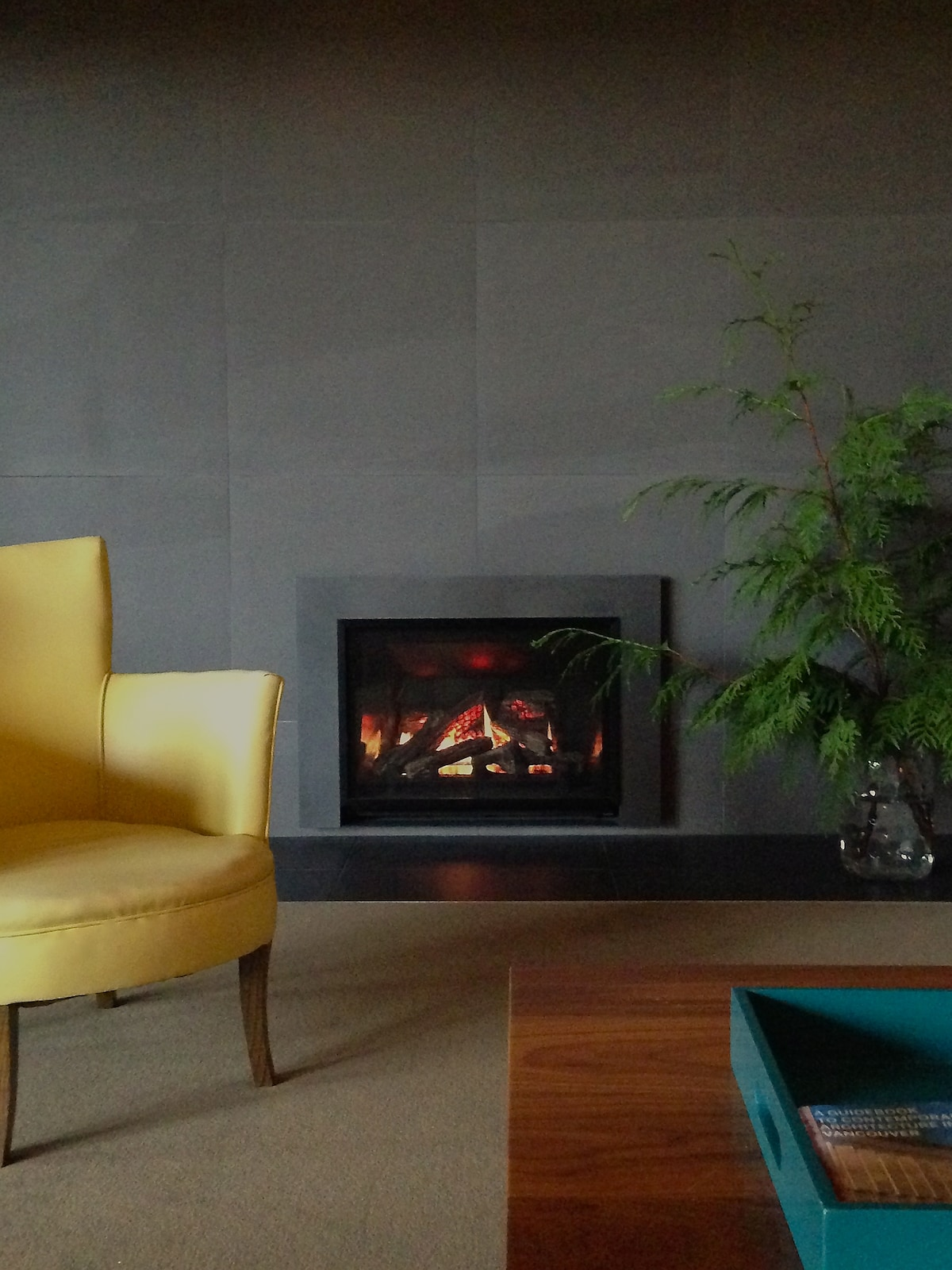remote control gas fireplace on a porcelain tile wall.