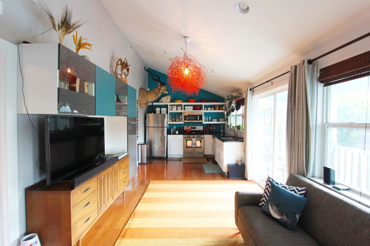 Living and dining area which is open to the kitchen. LED television with an awesome sound bar.