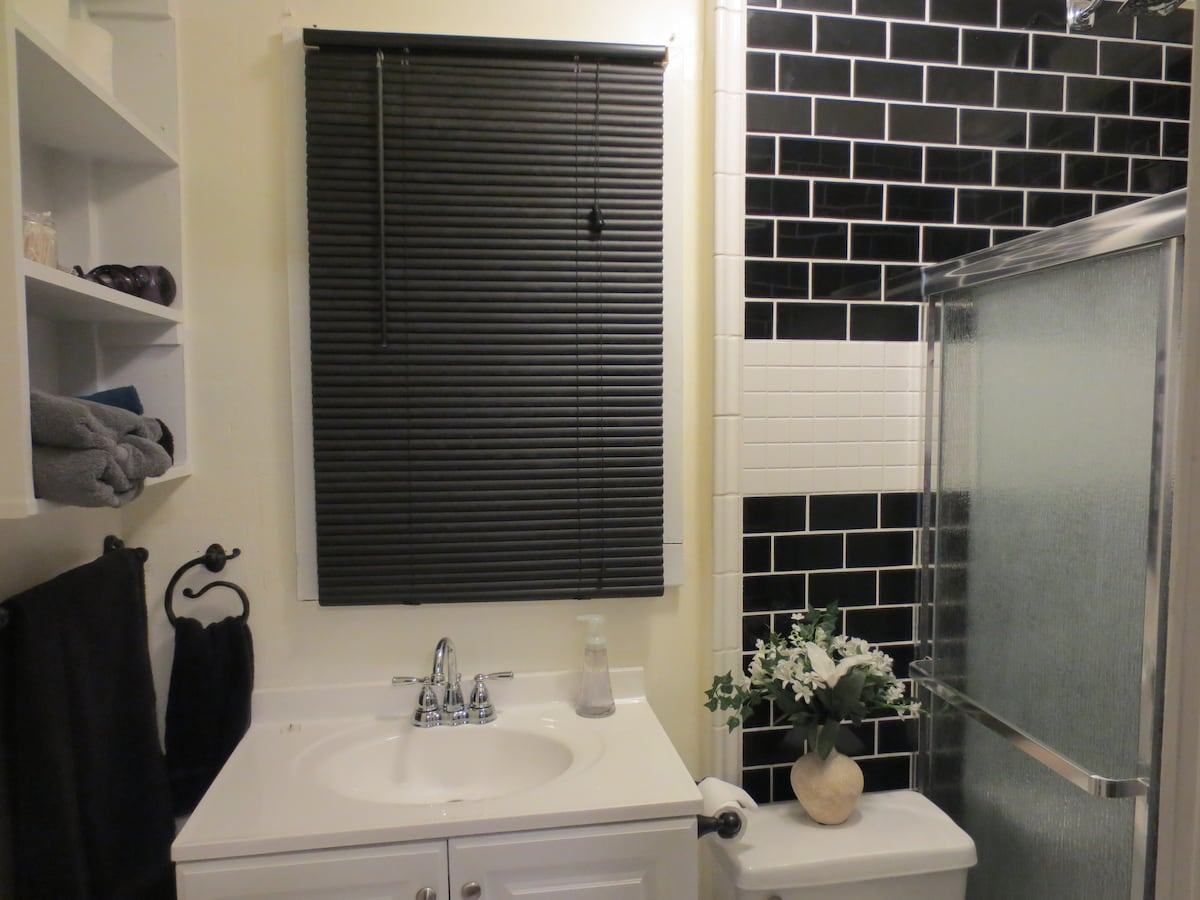 Art Deco Style New Tile Bathroom with fresh Towels & Suppies