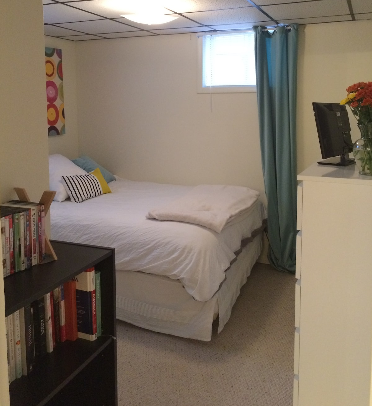 """19"""" TV in bedroom with cable. Two windows for extra light and fresh air."""