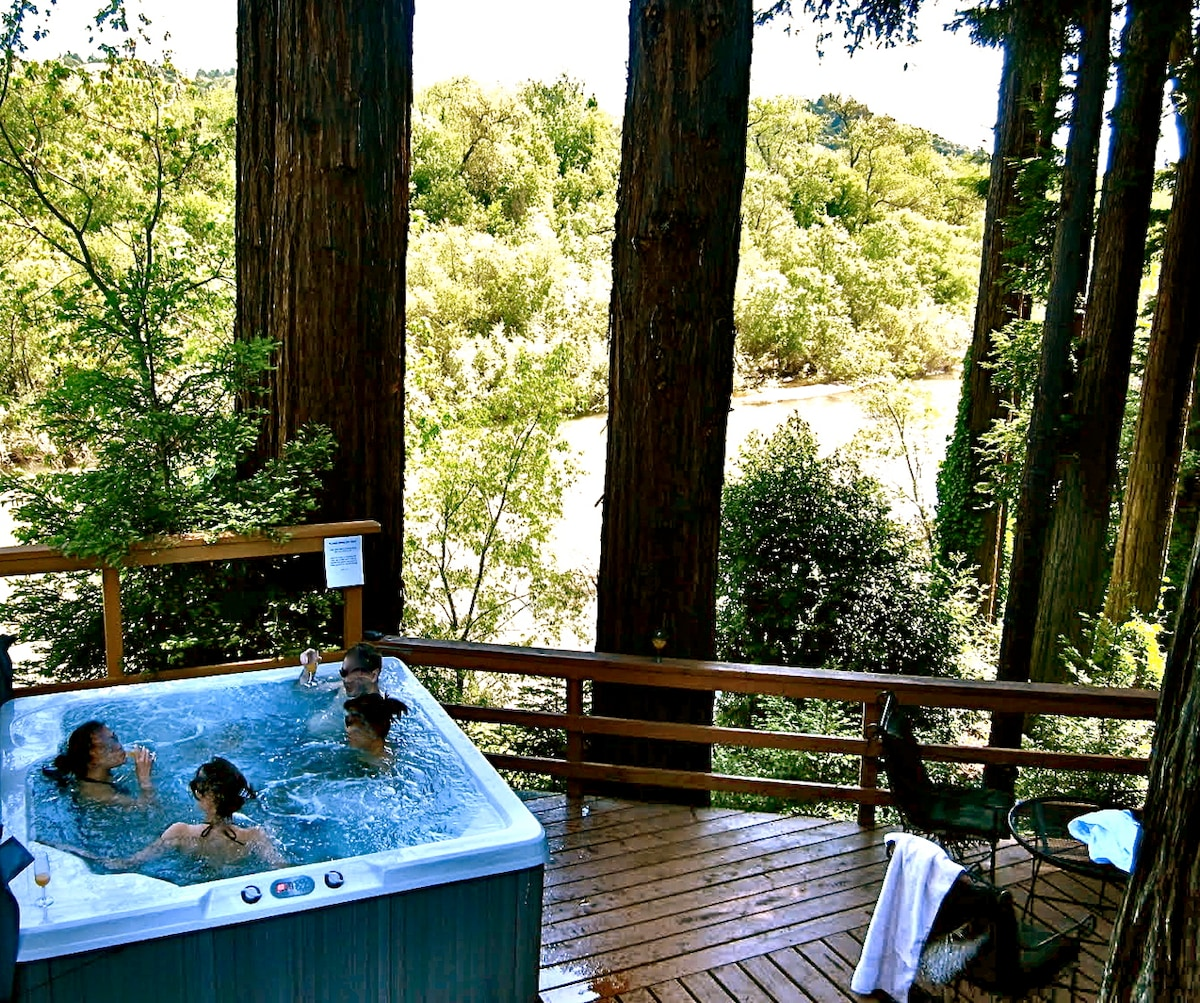 hot tub overlooking the river and redwoods