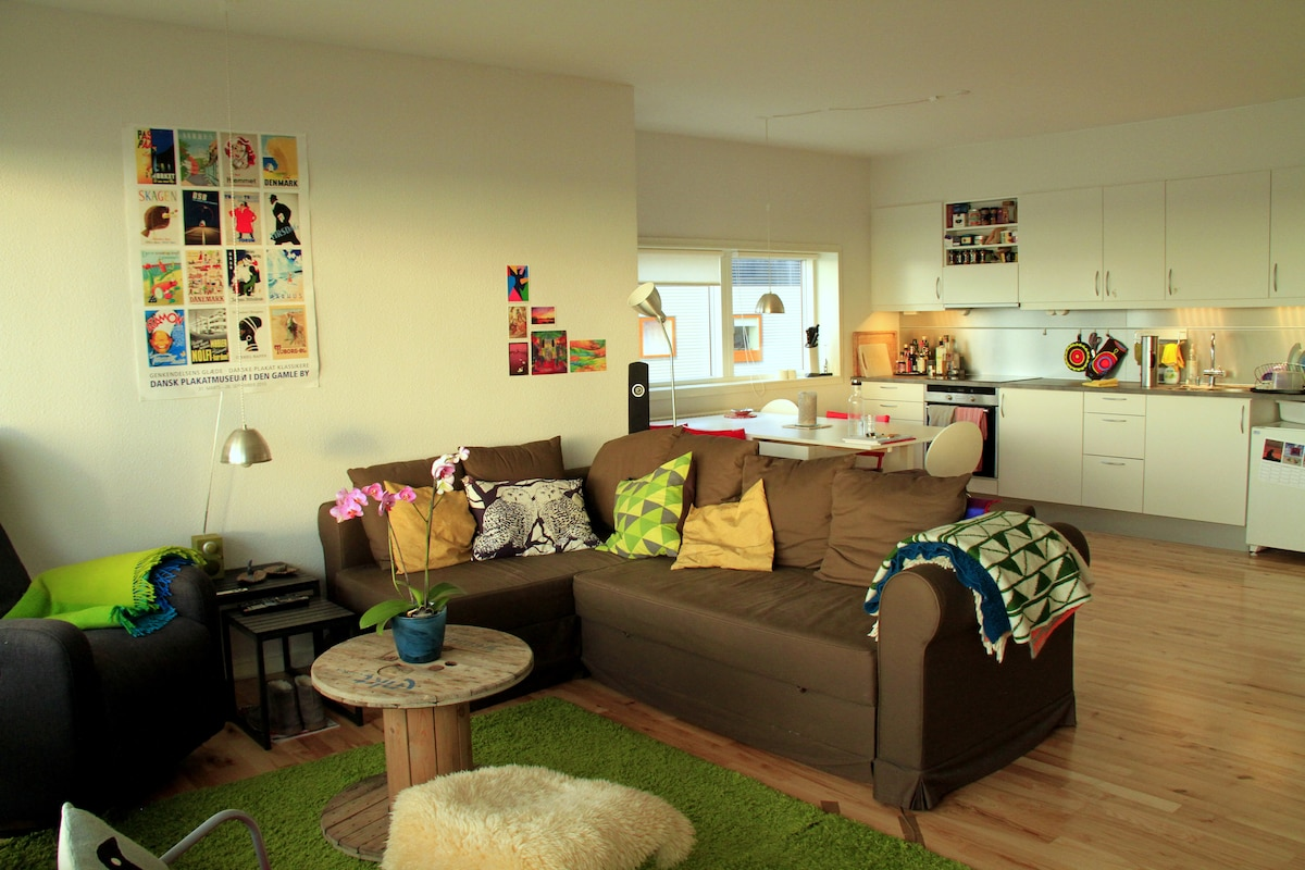 Living room and kitchen, which you're welcome to use.