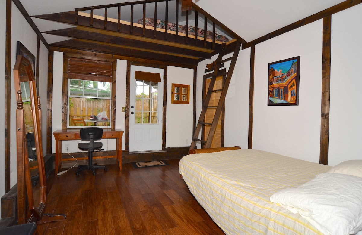 Queen bed on the main level and a full bed up in the loft.