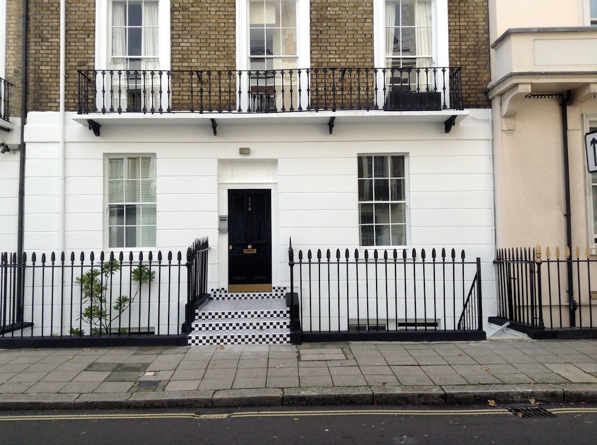 front of the building, the flat is snugly placed on the lower ground floor, through the private gate on the right hand side.