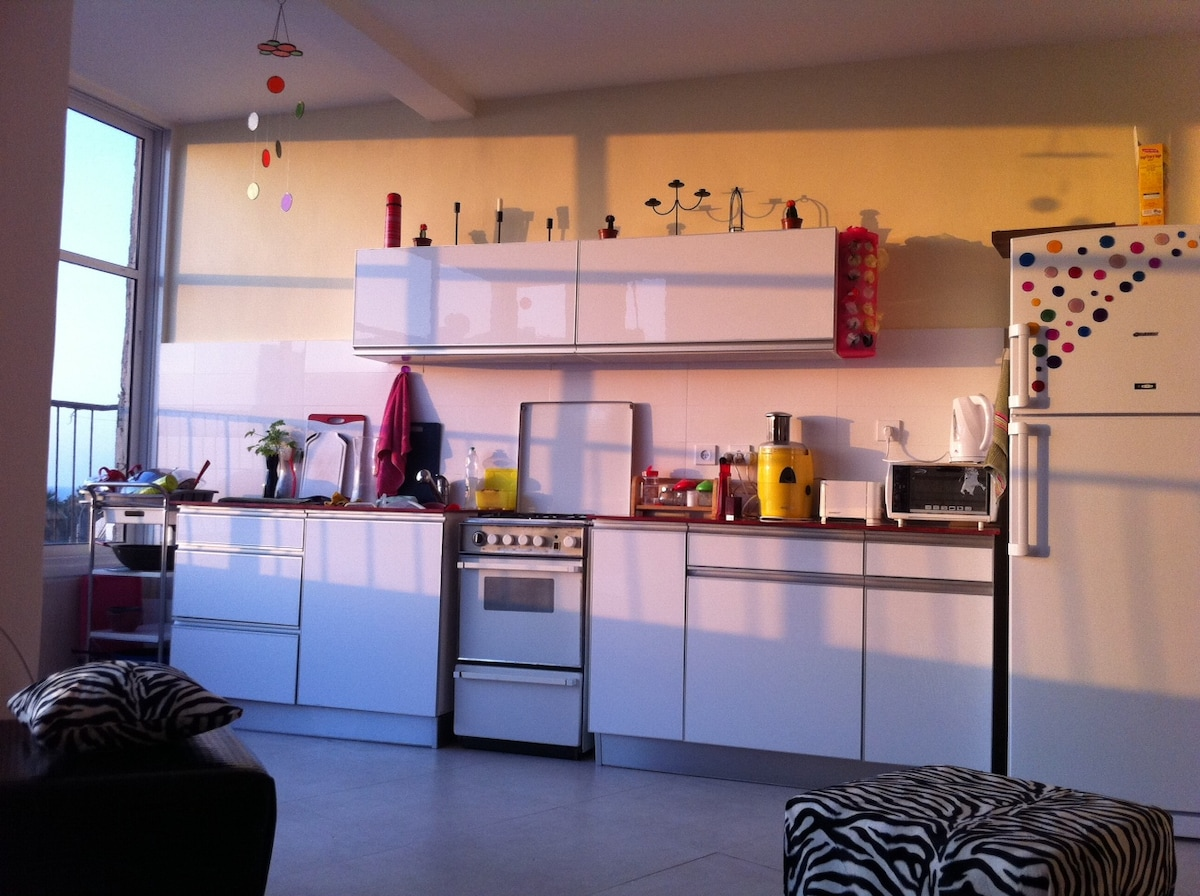 Opposite to the living room is the kitchen, also overlooking the sea