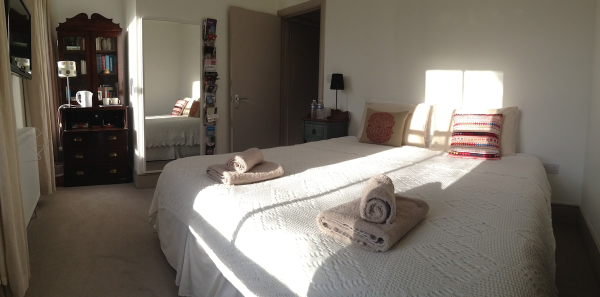 This is your bedroom located at the top floor with a super king size bed, fresh towels and additional blankets if needed - and lots of light when the sun is out