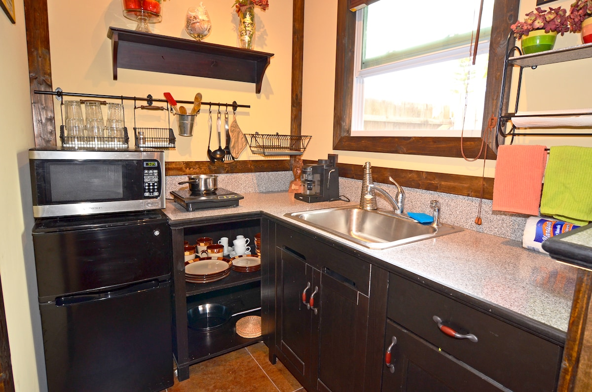 The kitchenette is equipped with dishes, towels, pots, pans, utensils, cook plate, microwave amp; mini fridge.