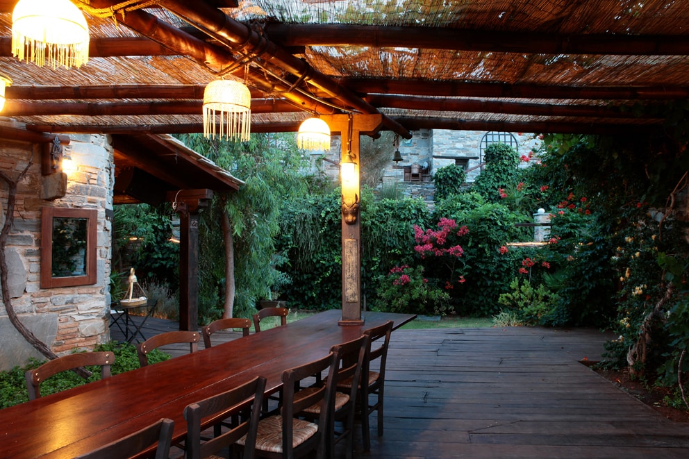 Al Fresco dining under a pergola with bamboo from Bali