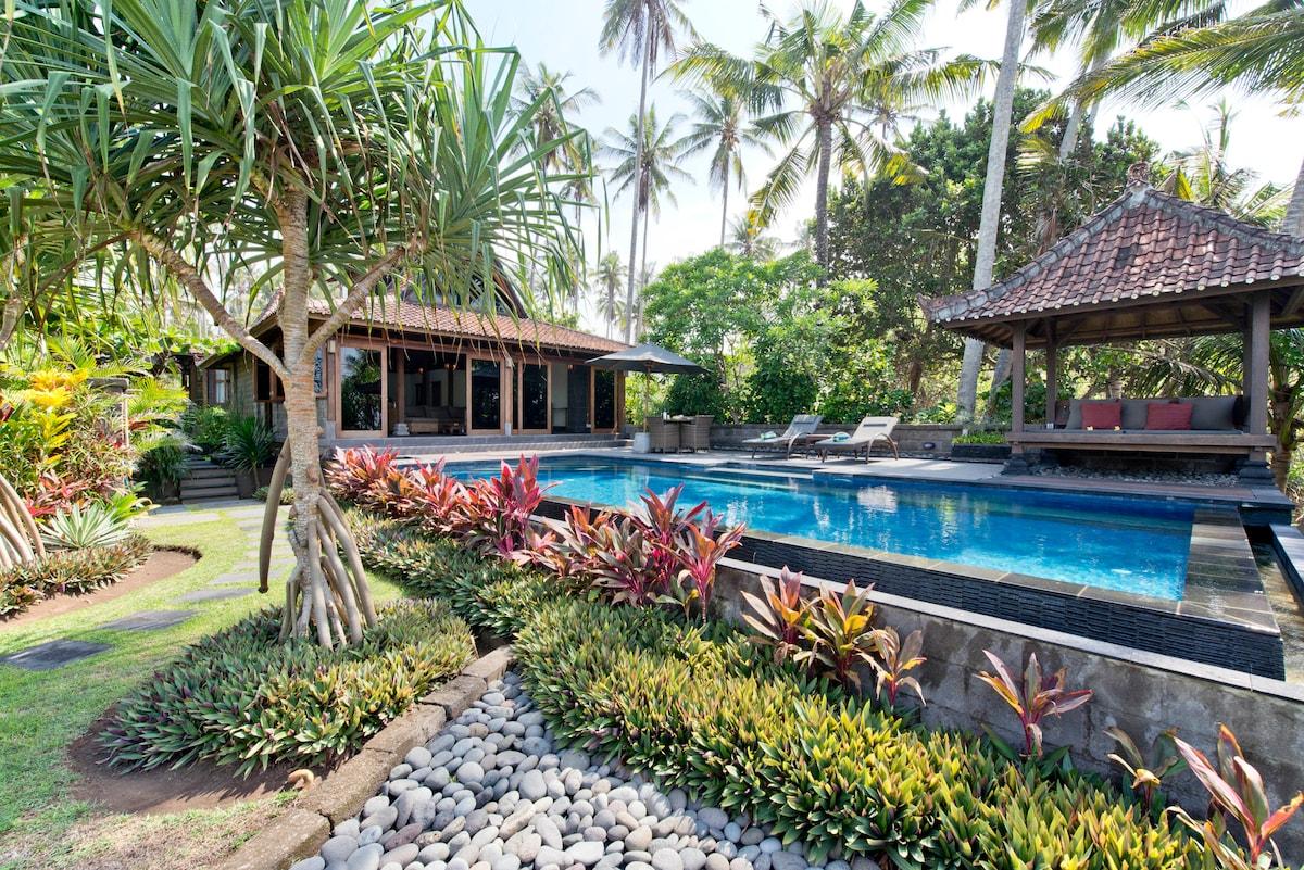 Tropical gardens surround villa
