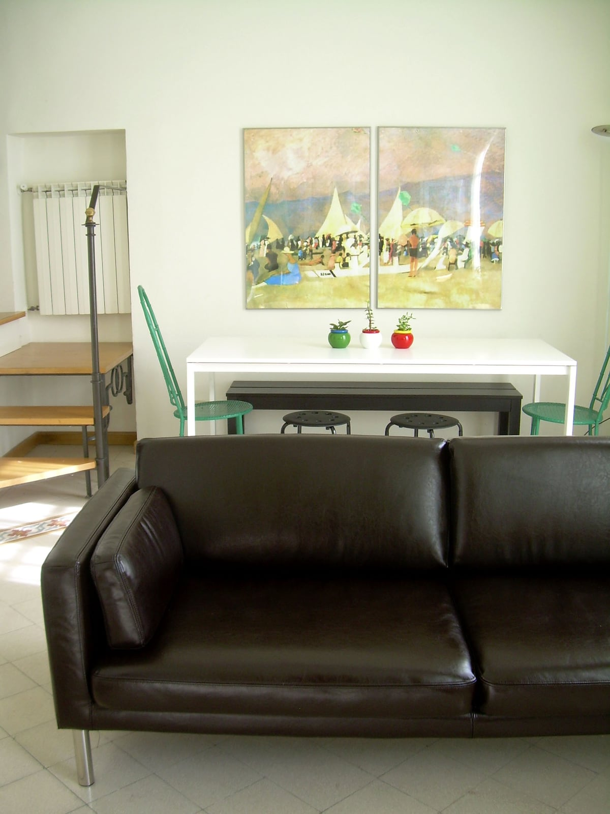 living: dining corner ( large table for 6 and more) flat screen TV, sofa, armchairs, bookcases