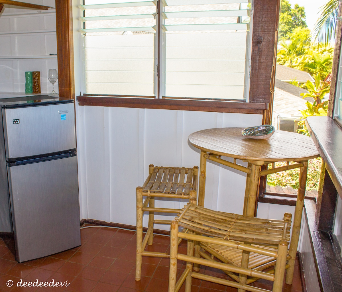 small refrigerator for take away / closet area and table with peek a boo ocean view (when trees are trimmed)