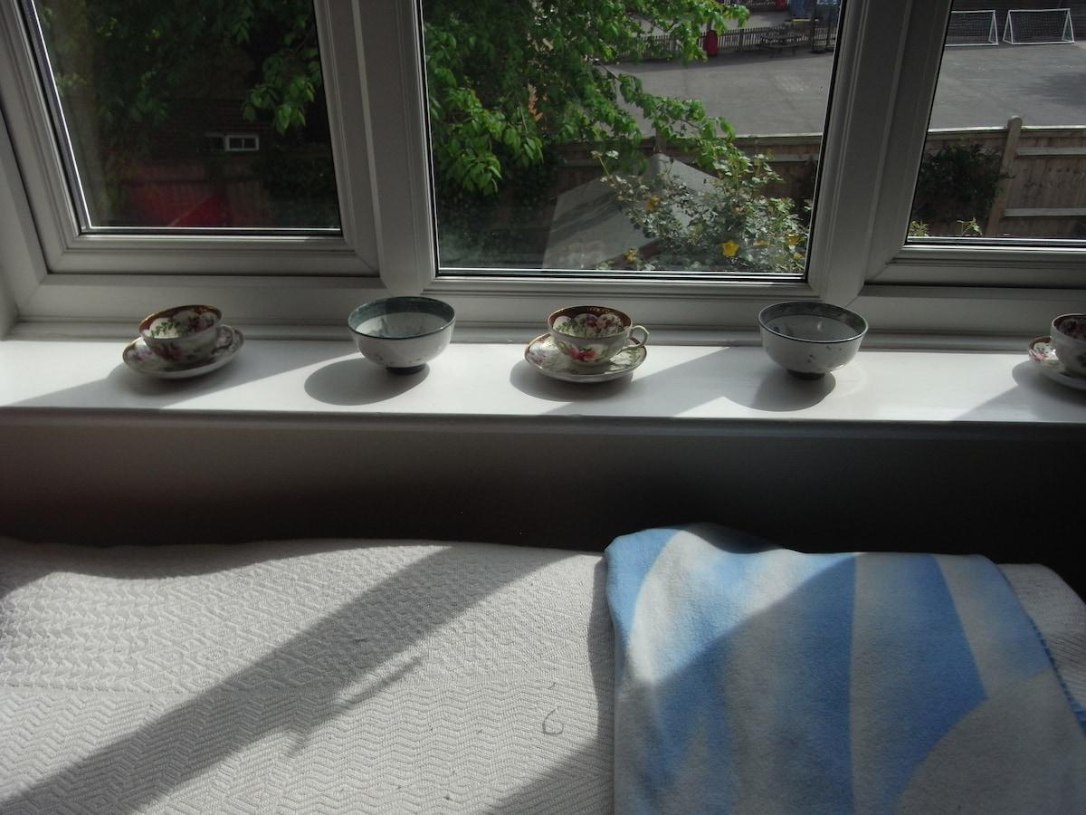 Sunny Bedroom window sill, over looking garden.