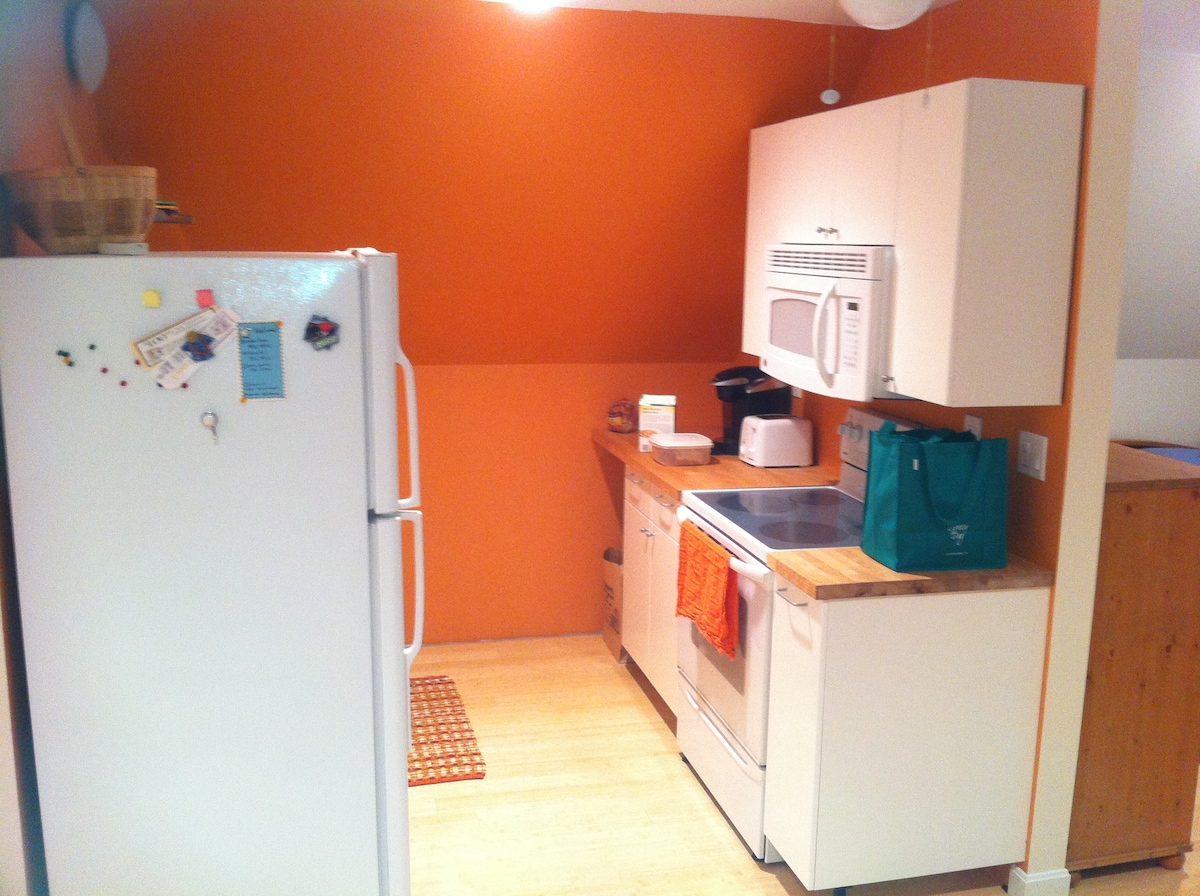 full sized fridge, birch counters, electric oven and stove, microwave