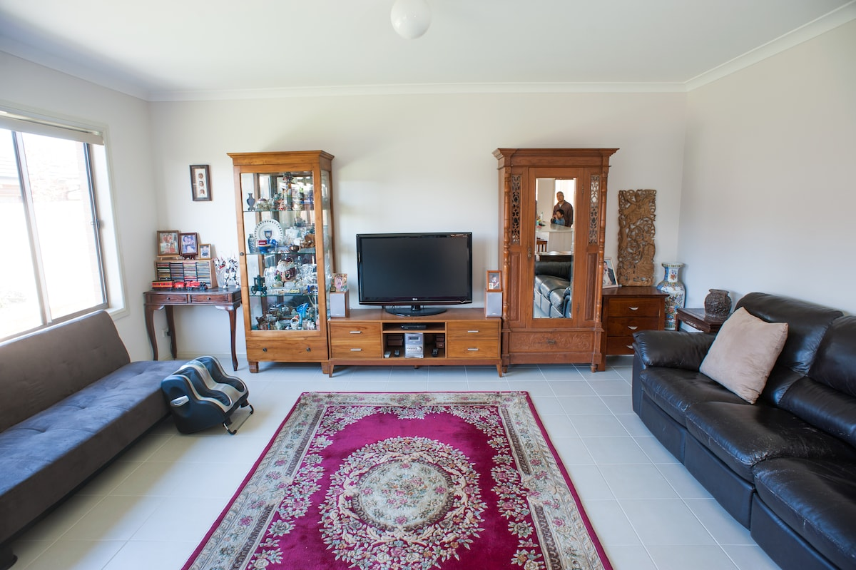 The spacious living room, with a fusion decor style - looking out to the back garden