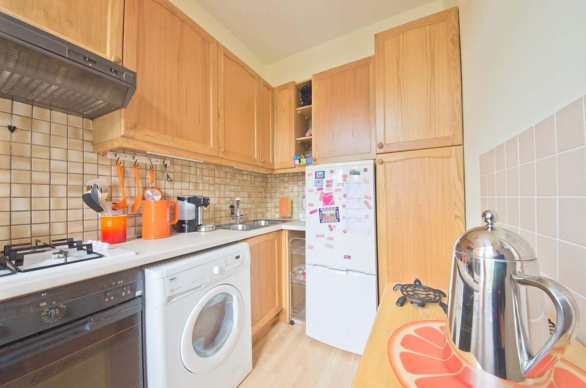 The kitchen has a funky orange theme which I love to add to by buying orange accessories.  You can make use of the kitchen to prepare drinks.