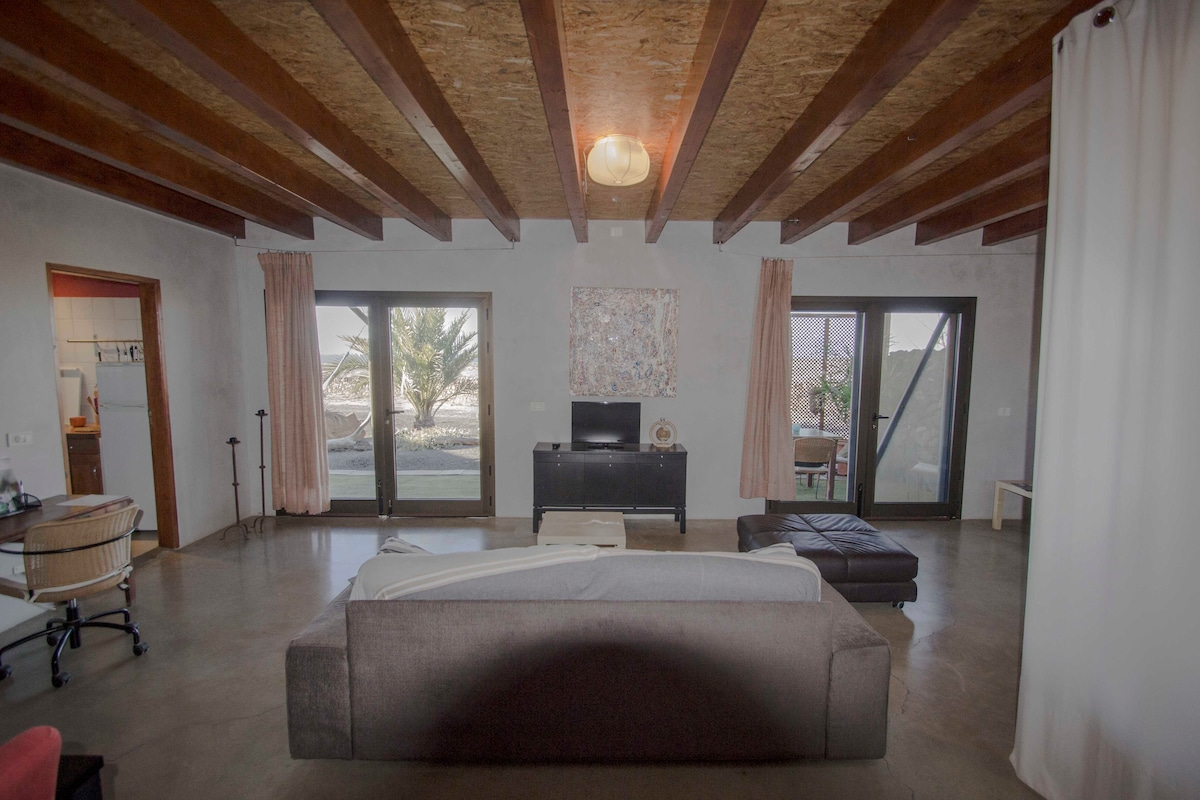 Polished concrete floor. Wooden roof. terrace views.