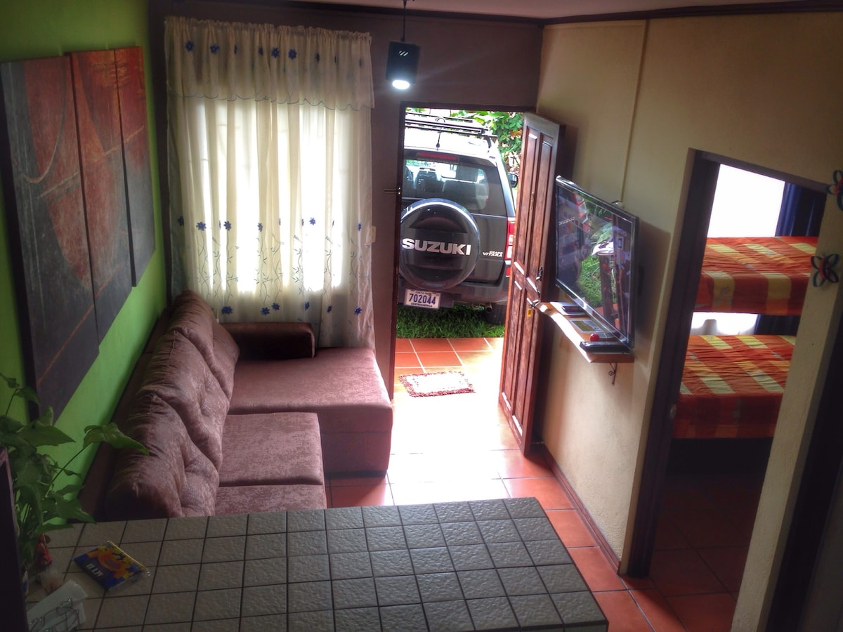 """Living room with couch and 49"""" TV with cable + fully equipped kitchen (refrigerator, hot plate, electric skillet, rice cooker, blender, microwave,  coffee maker).  Tea, coffee, salt, sugar included."""