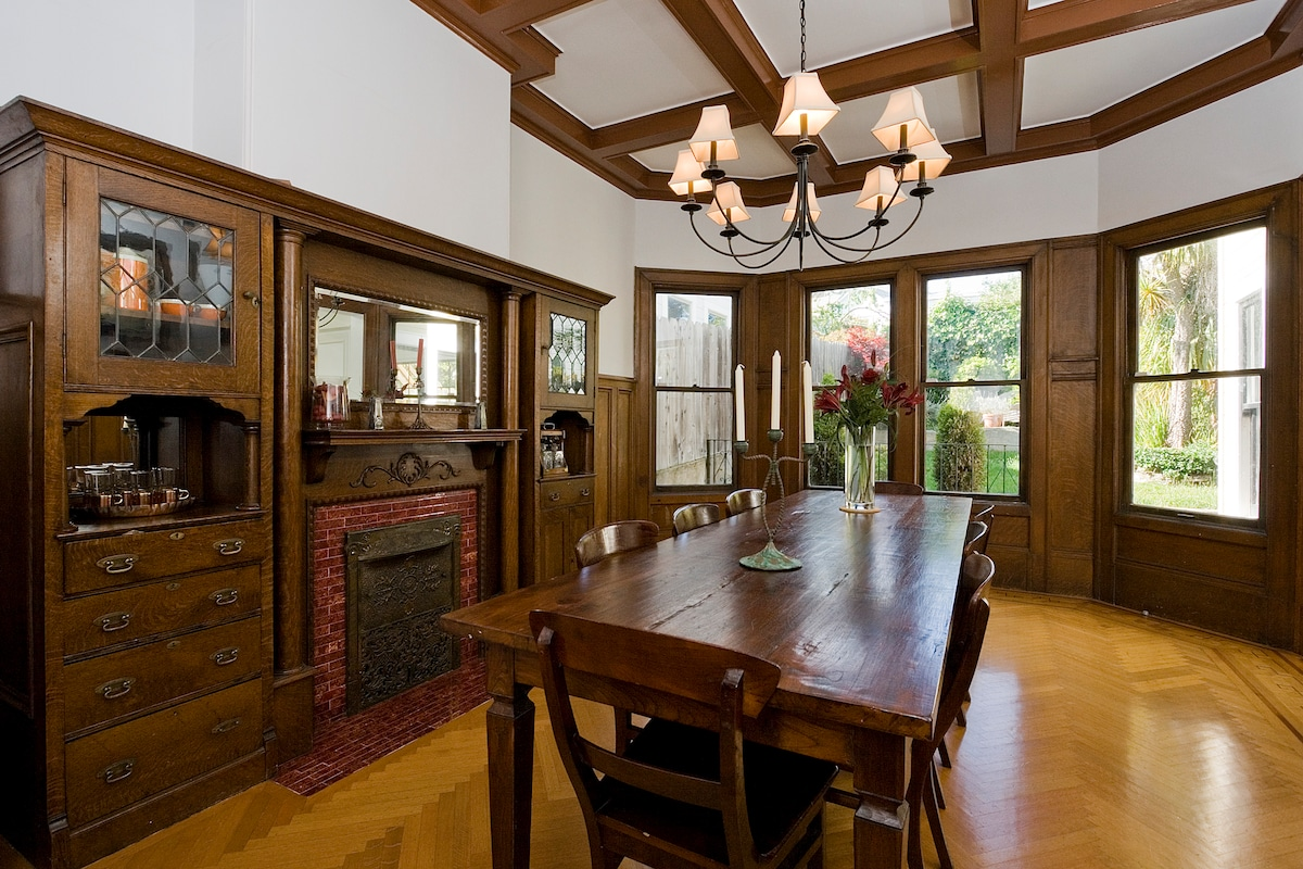 Stunning Formal Dinning Room with antique table (seats 10), wood beams and built in server and fireplace